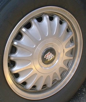 91-96 BUICK REGAL CUSTOM 15x6 17 Spoke with Covered Lugs A MACHINE/SILVER