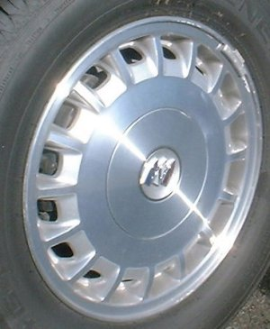 05 BUICK ALLURE 15x6 Flat 16 Slot w Covered Lugs MACH/SILVER OPT PG5