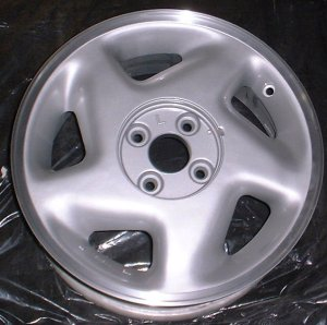 91-93 GEO STORM 15x6 Soft 5 Spoke with Covered Lugs LEFT SILVER