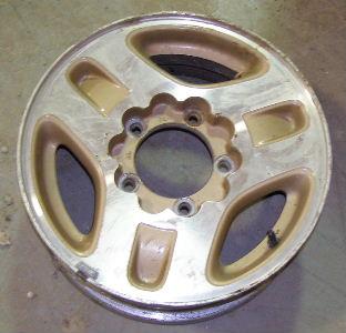 97-98 GEO TRACKER 15x5.5 Wide Flat Notched 3 Spoke MACHINE/GOLD