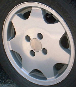 90-92 VOLKSWAGEN JETTA 14x6  Flat Tapered 7 Spk 357601025N B MC POLISH/GREY